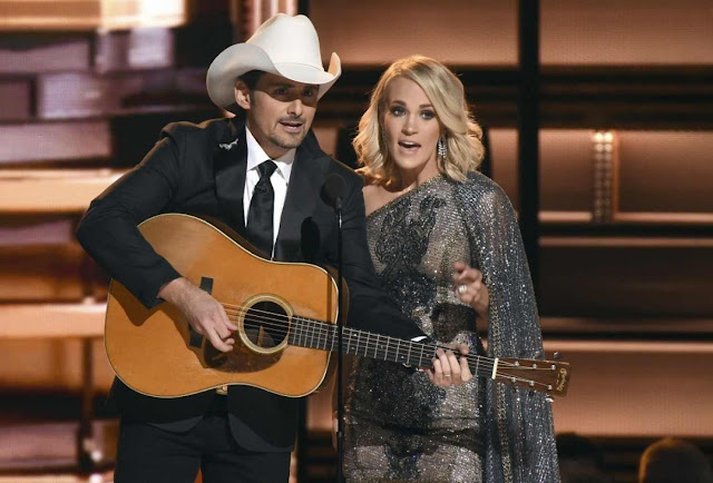 Brad Paisley, left, and Carrie Underwood hosted the CMA Awards again.