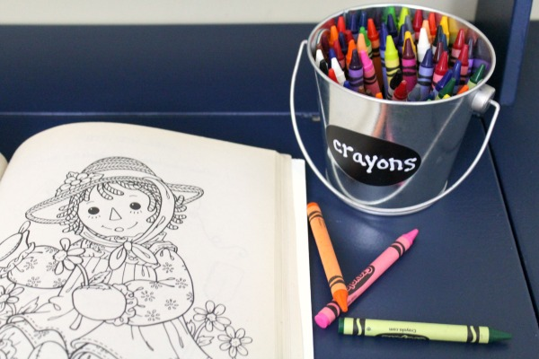Organized art station for kid's art and craft supplies: Use tin buckets to easily label and store crayons and other art supplies