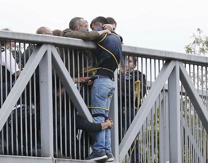 Faith in Humanity - When a man climbed off the bridge railing near Golders Green, North London, members of the public rushed and held on to the suicidal man through the railings. They held on for an entire two hours until a fire engine arrived to save the man.