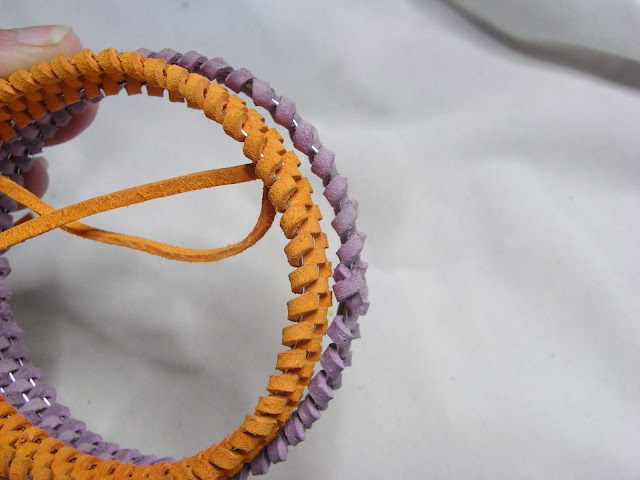The diameter of the woven orange bangle is now smaller than the purple one.