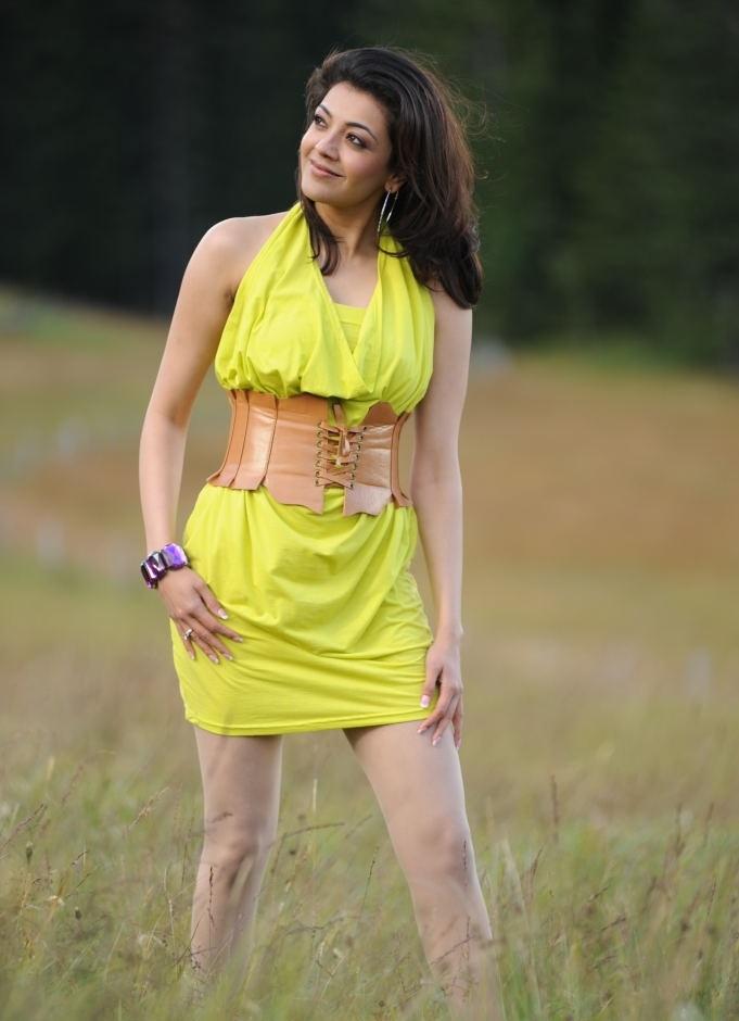 Kajal Agarwal Legs Show Sizzling Sleeveless Yellow Dress Stills