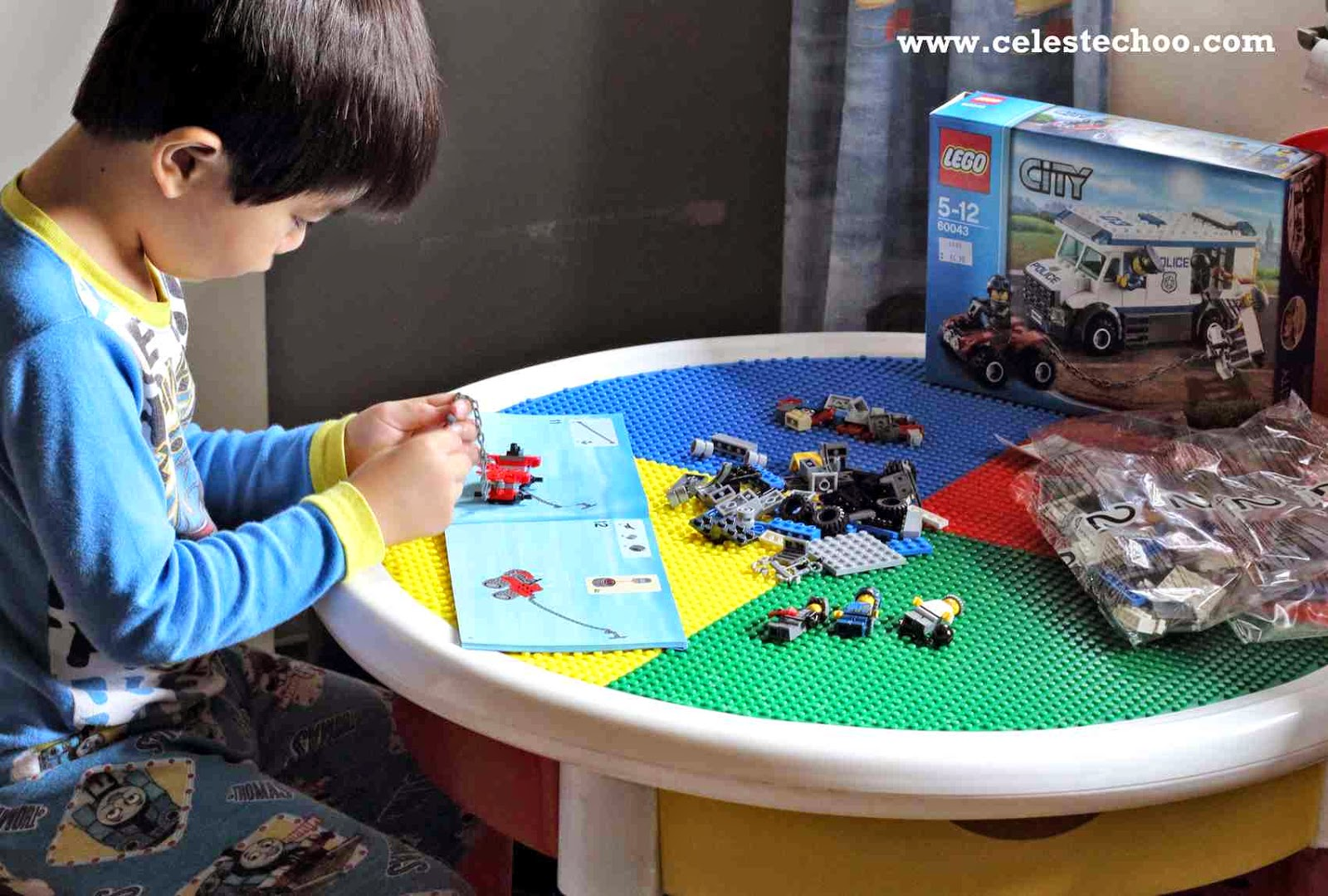 boy-fixing-lego-city-police-truck-toy