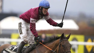 Grand National: Rule The World wins under David Mullins