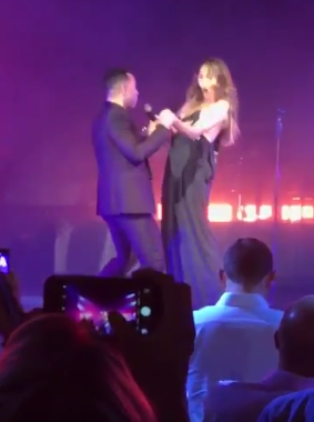 Chrissy Teigen suffers a nip-slip while on stage with her husband during his show (video)