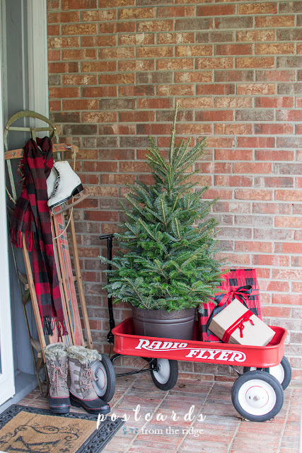 Love this cozy Christmas porch. Lots of great Christmas decorating ideas on this site.