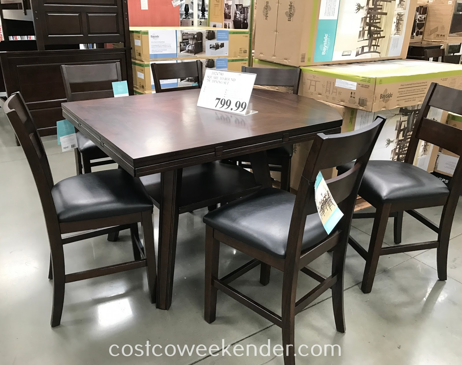Furnish your home with the Bayside Furnishings Counter Height Square to Round Dining Set