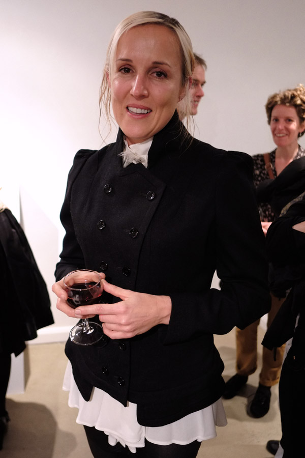 Jo Piper artist portrait, tenmoregirls - glory box - Sydney 2012, grey flannel double brested riding jacket, white blouse and black leggings.