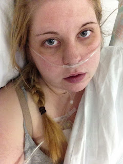 A young girl with her hair in a braid with a nasal oxygen cannula