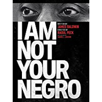 "close up of James Baldwin's eyes as he looks out over the words ""I am not your Negro"""