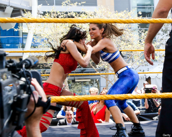 Menounos and Eva Marie in the ring for WWE's Summerslam Axxess on Sunday