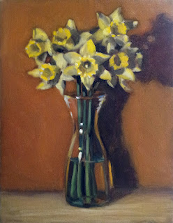 Oil painting of a bunch of daffodils in a 1 litre glass carafe.