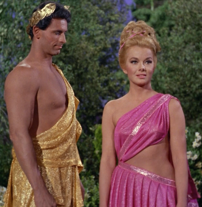 God Apollo checking out the parts on Lieutenant Carolyn Palamas, played by  actress Leslie Parrish.