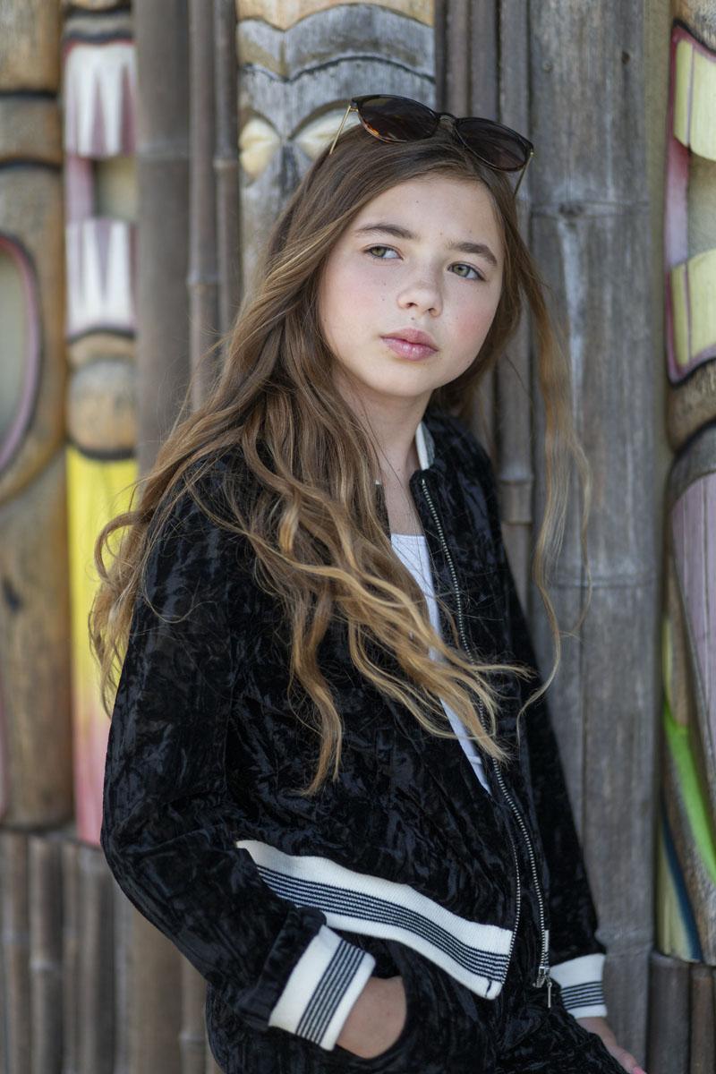 girl tween model wearing Graffiti Gloss black crushed velvet track suit