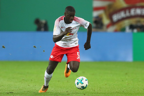 Dayot Upamecano of Leipzig runs with the ball during the DFB Cup round 2 match between RB Leipzig and Bayern Muenchen at Red Bull Arena on October 25, 2017 in Leipzig, Germany