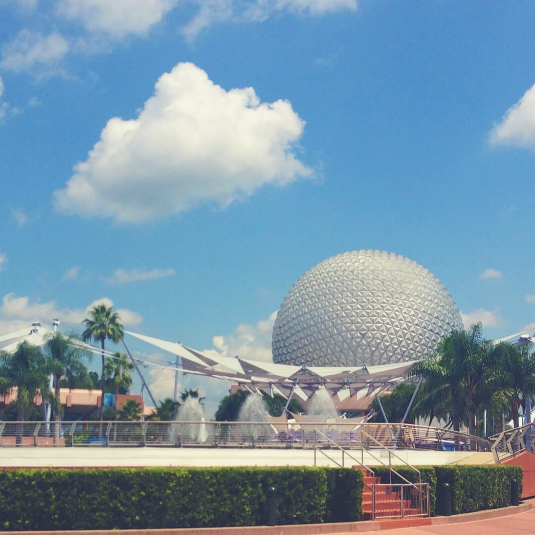 Spaceship Earth from inside Epcot near the fountains.