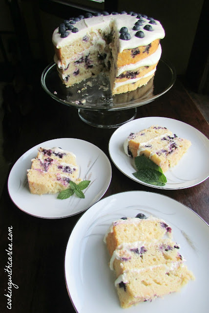 thee slices cut and served with remaining cake in background