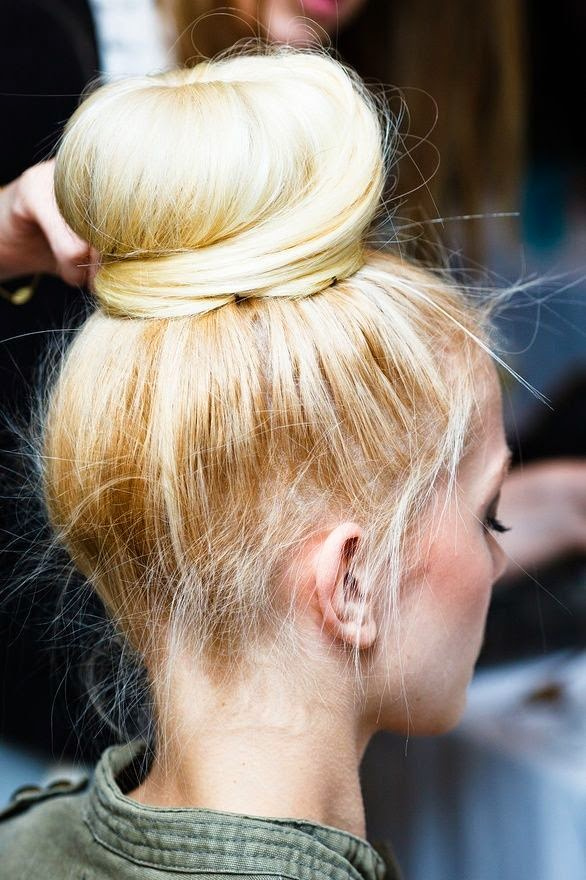 Take your sock bun to new heights by teasing your hair before you roll it with a bun form  Se more http://www.womensandmenshairstyle.net/