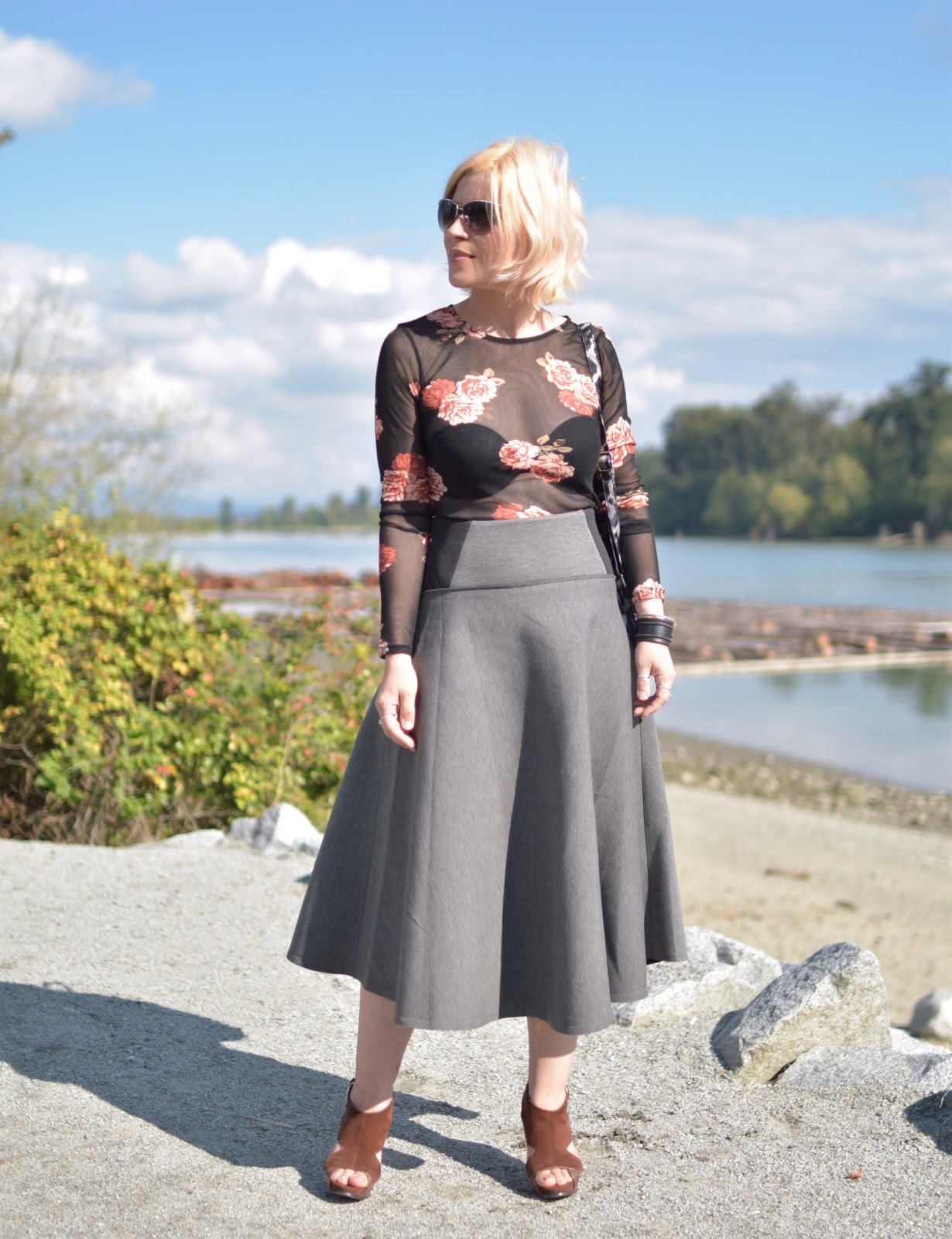 Monika Faulkner styles a flared midi skirt with a sheer floral top and suede platform heels