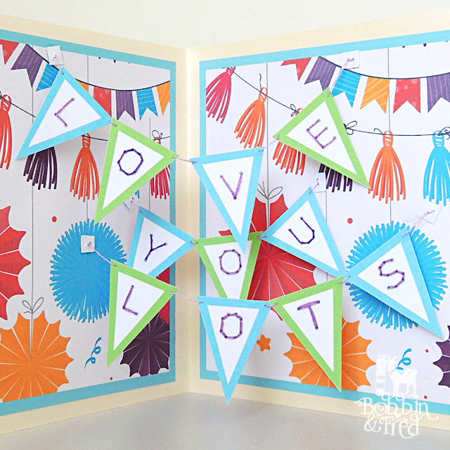 Surprise pop up bunting in greeting card that spells 'Love you lots'