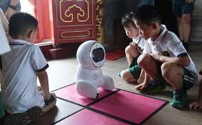 Robot Teachers Invade Chinese Kindergarten