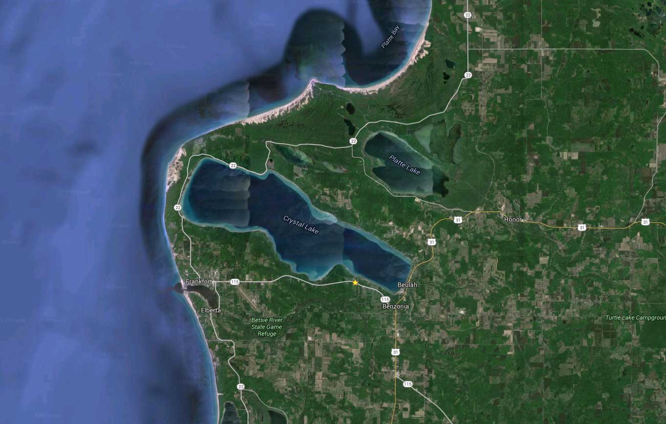 google maps shows why a waterway between lake michigan and crystal lake might have worked the path wasn t through the dunes at the end of crystal nearest