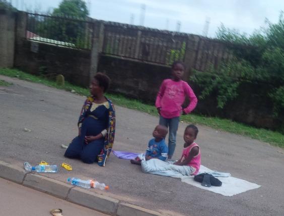 pregnant woman kids abuja streets