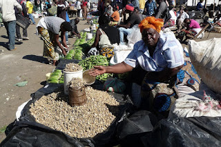 Selling vegetables in Zambia on market day