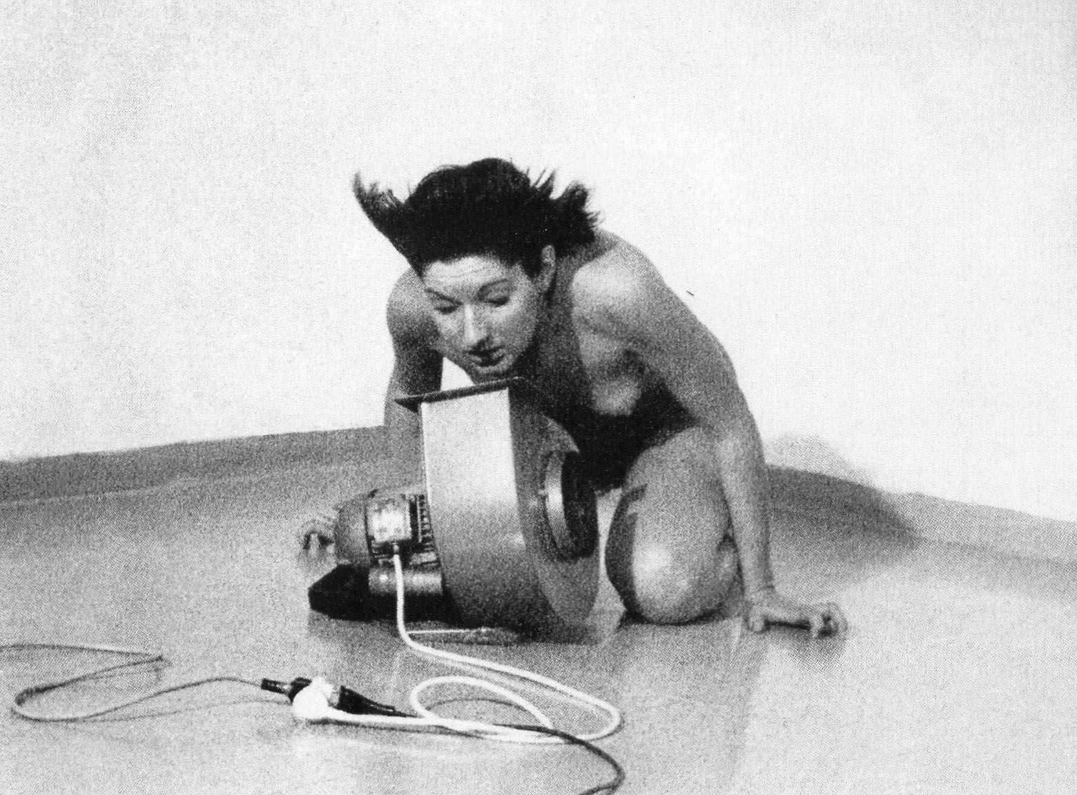Abramović kneeled alone and naked in a room with a high-power industrial fan.