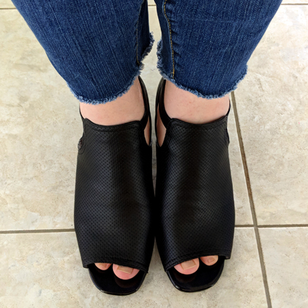 image of my legs below the knees; I'm wearing blue jeans with rough cuffs, and black open-toed heeled booties