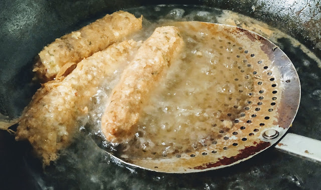 Deep frying the chicken roll in oil food recipe dinner ideas