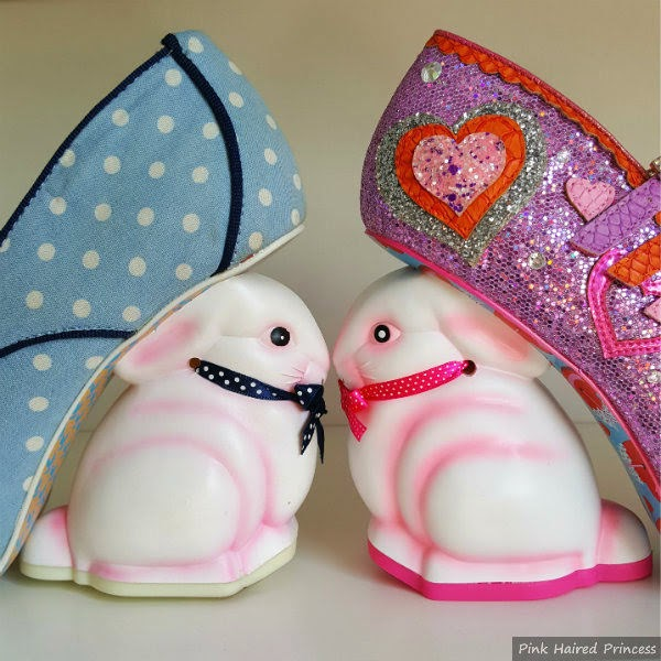 side view of bunny heels facing each other, old one paler than the new neon