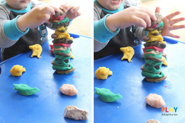 Carefully balancing rocks on playdough