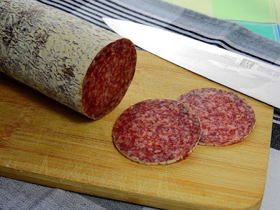 Dry Aged Salami Round Being Sliced