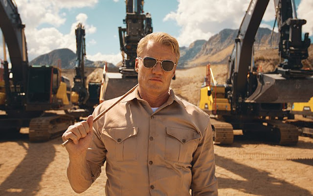 Dolph Lundgren gives Excavators a workout