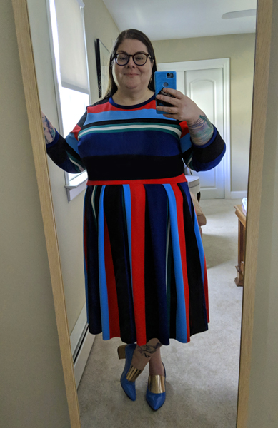 image of me standing in a full-length mirror wearing a multi-color striped dress and blue and gold pumps