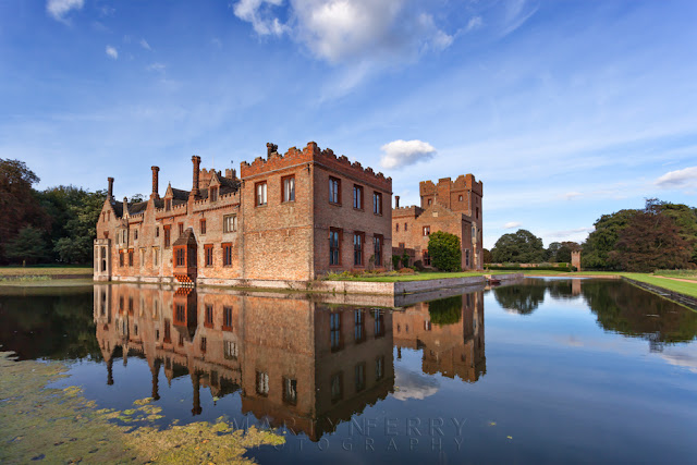Reflection of Oxburgh Hall in Norfolk on a late summers evening