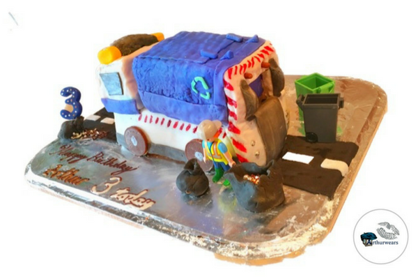blue bin lorry recycling garbage truck birthday cake on a road