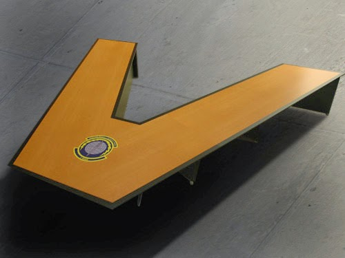 Large v-shaped conference table made to seat a crowd. With embedded logo made in USA by Franz.