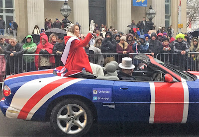 Miss Great Britain waves to crowds from car in British colours