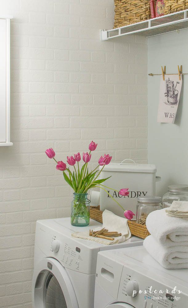 laundry room makeover with brick wallpaper