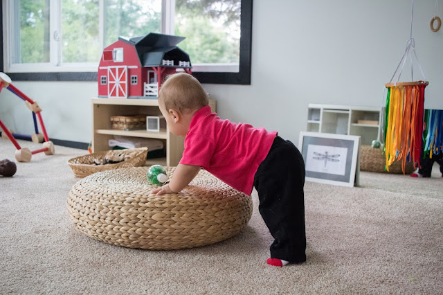 Adding a small footstool to your Montessori baby environment can be an interesting gross motor challenge and the perfect way for a baby to practice pulling up