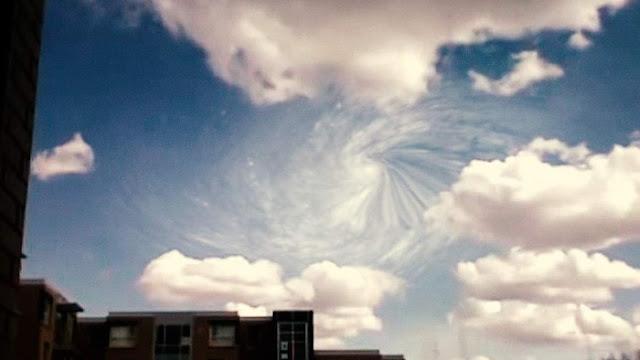 UFO memasuki pusaran awan di atas fasilitas CERN