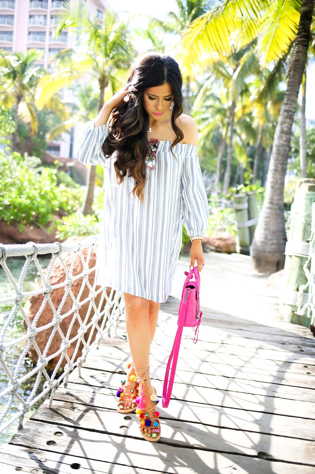 pink mini phillip lim, fuchsia phillip lim mini handbag, lush off the shoulder dress nordstrom, elina linardaski penny lane sandals, gladiator sandals with charms and poms, sandals with poms that tie around ankle, atlantis bahamas fashion blog, emily gemma blog, the sweetest thing blog, how to style a pink handbag during winter, what to do in atlantis bahamas, where to stay in the bahamas, what to wear on spring break, outfit ideas for beach trips, odysssey turquoise ring, pink cross body handbag, nordstrom affordable dresses for spring, brunette bayalage hair, bellami balayage hair extensions, fun sandals for spring, cute gladiator sandals for spring, penny lane sandals, pink wild fox sunglasses, wavy beach curls hair, curling wand for wavy beachy curls