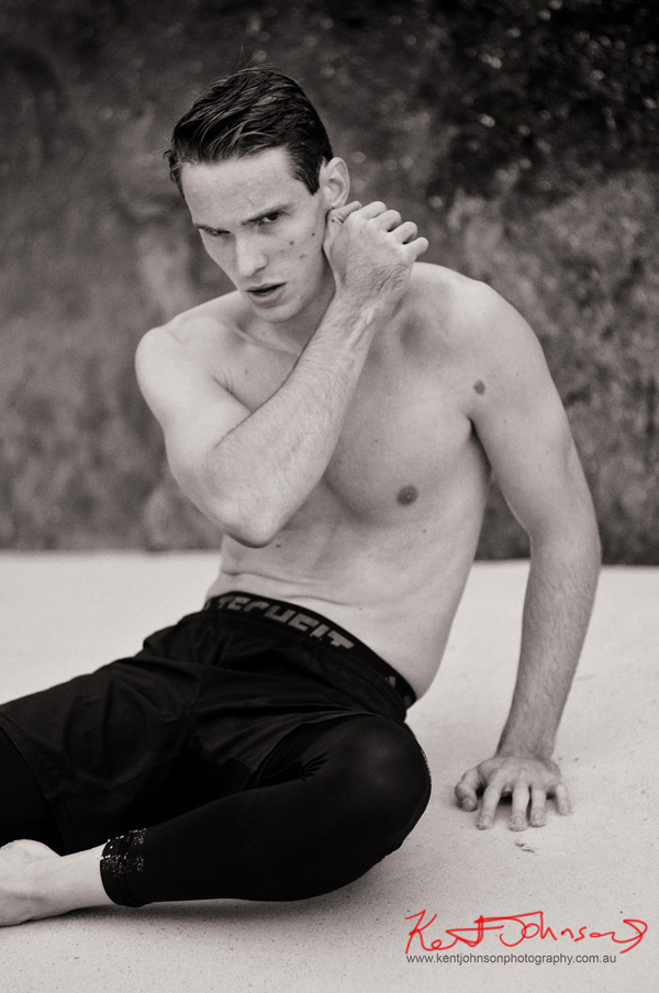 Black and White body shot on the beach for a male modelling portfolio - Photographed by Kent Johnson, Sydney, Australia.