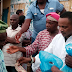 Ekiti House of Rep member shares portion of rice and N500 to members of his constituency