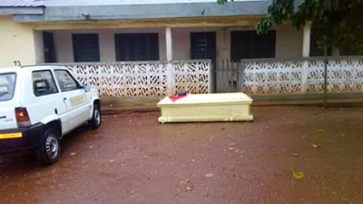 Photos: Coffin and dead chicken dumped in front of an Electoral Commission office