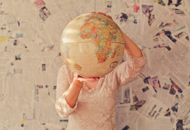 Traveling Creates Opportunities, Globe holding by a lady - Image: Unsplash