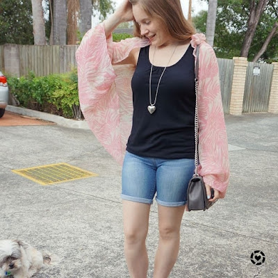 awayfromtheblue instagram pink leaf print rectangular scarf tied as a kimono black tank denim shorts