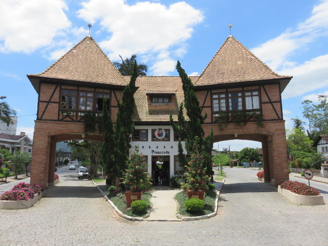 Pomerode's gate. A brown timber framing style construction that marks one of the entrances to Pomerode.