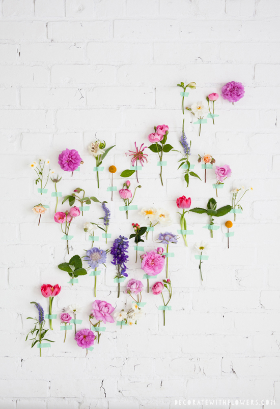 Flowers taped on the wall from Decorate with flowers by Holly Becker and Leslie Shewring.